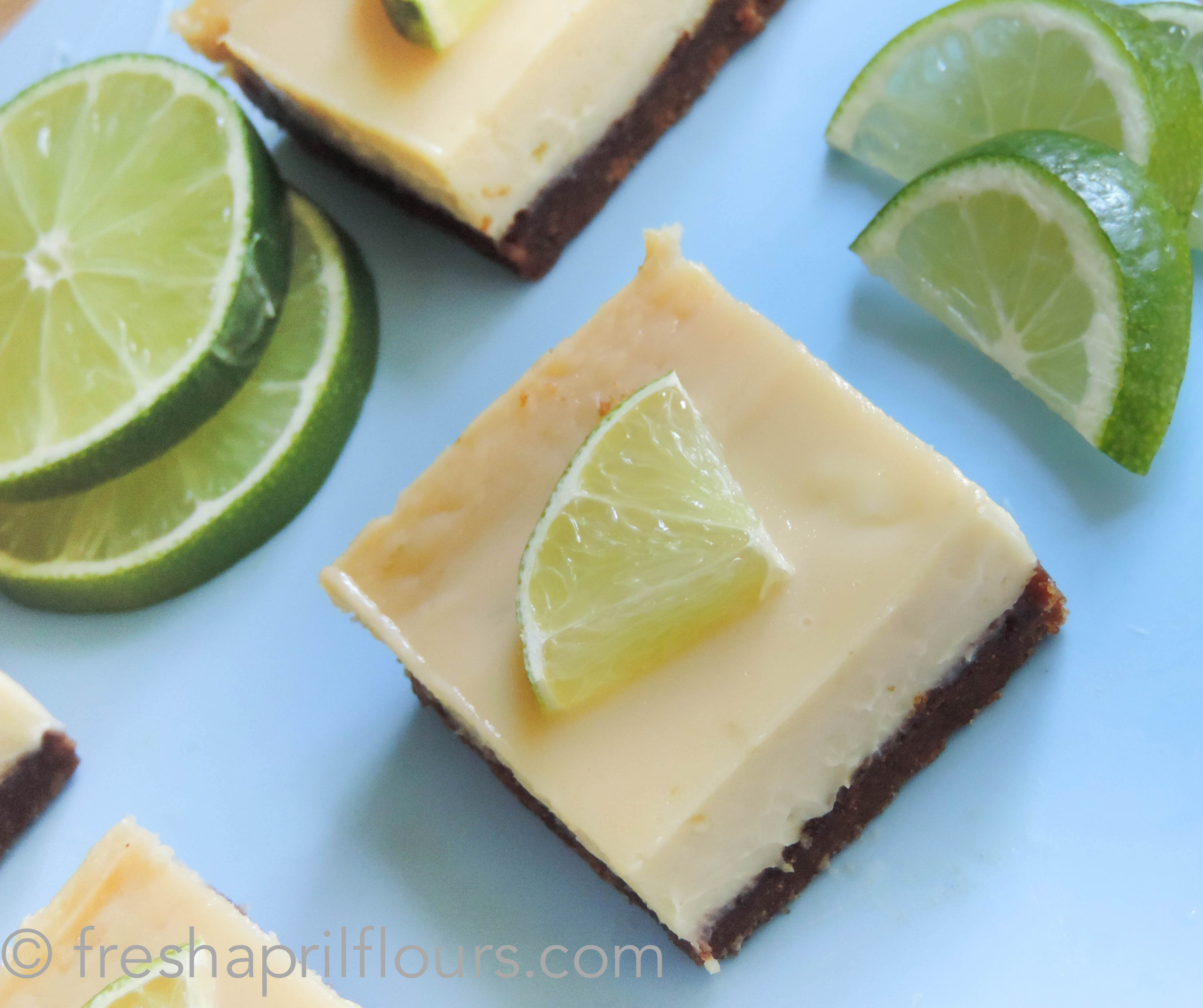 Key Lime Pie Bars: a creamy tart filling on top of a buttery graham cracker crust... Much easier than a whole pie!