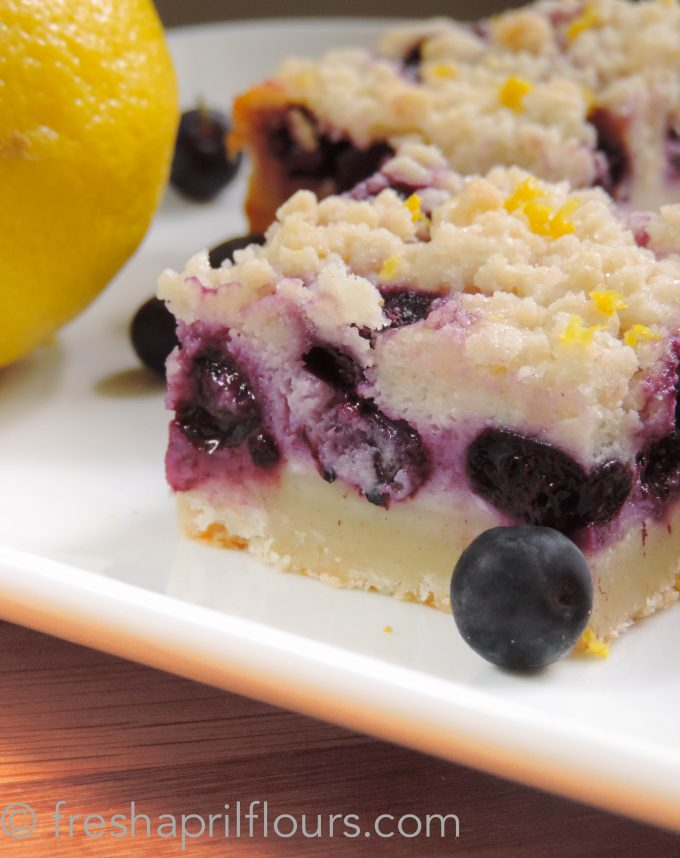 Blueberry Lemon Pie Bars: Creamy and sweet pie bursting with blueberries and citrusy lemon on top of shortbread crust. In portable bar form!