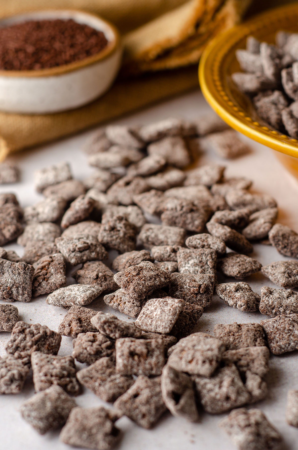 brownie batter puppy chow scattered on a white surface