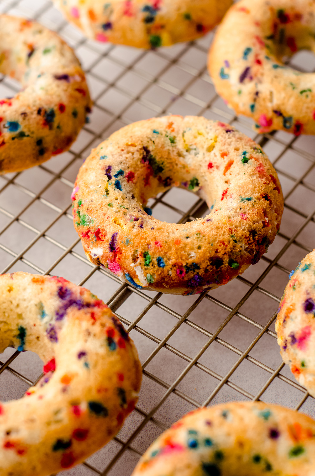 baked funfetti donuts cooling on a cooling rack