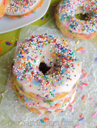 Funfetti Donuts: Glazed donuts with plenty of sprinkles inside and out! Baked, not fried, and oh-so simple.