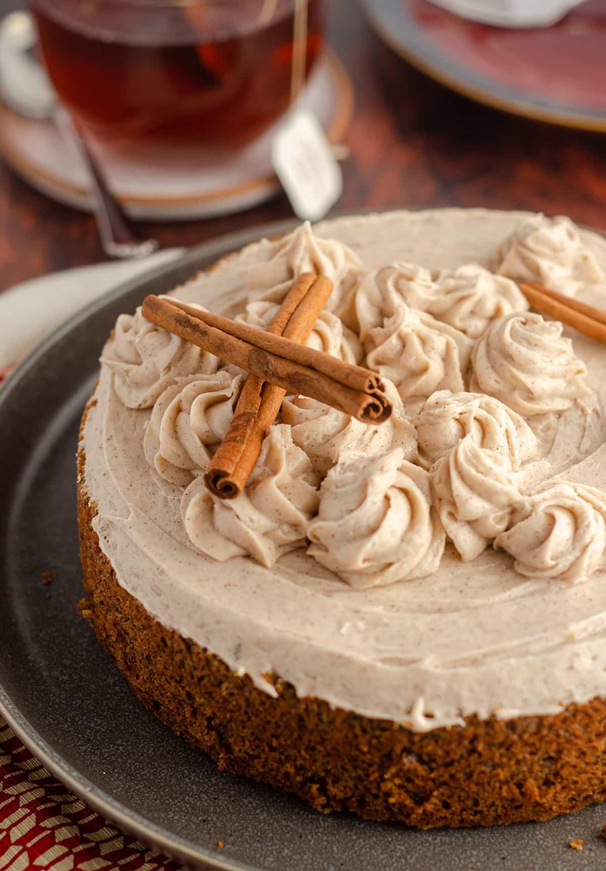 whole chai cake decorated with cinnamon sticks