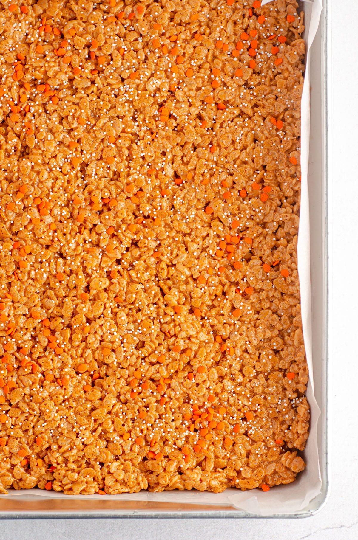 pumpkin rice krispies treats in a pan