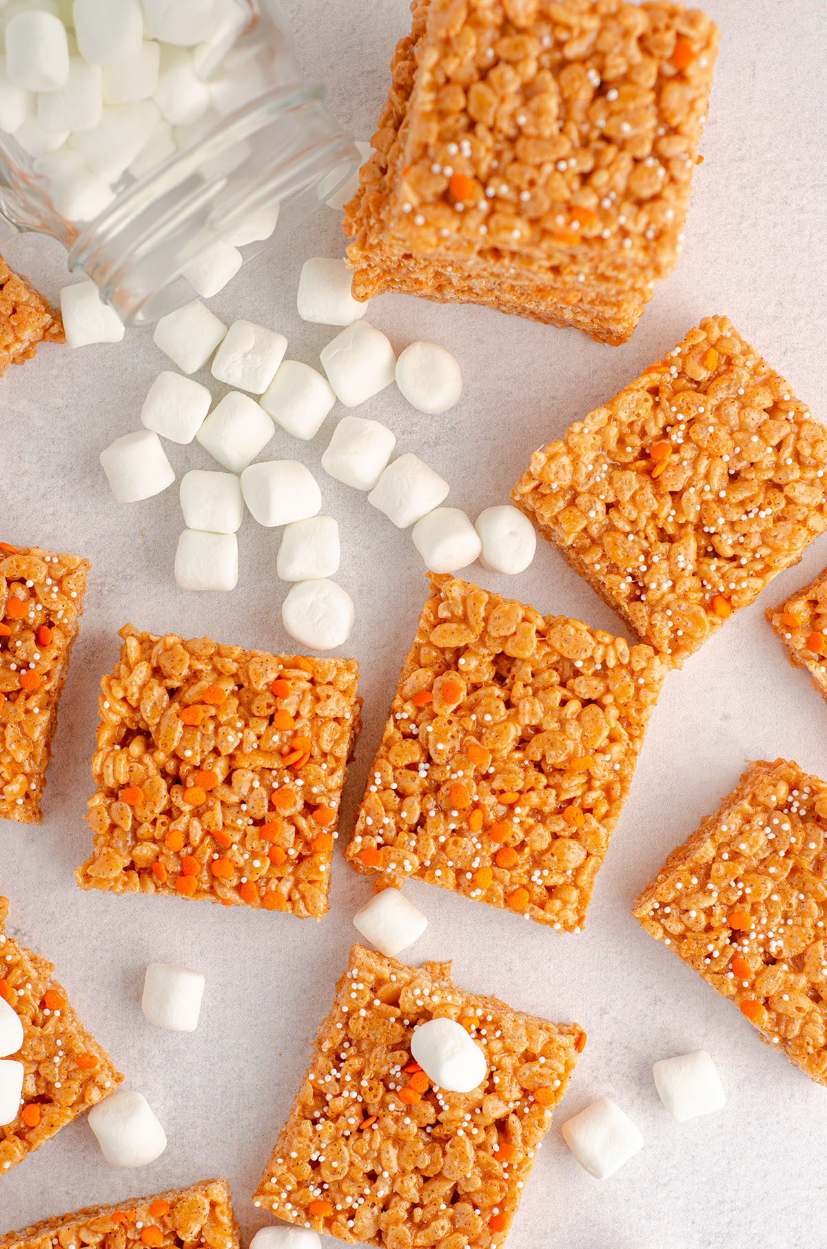 aerial photo of pumpkin rice krispies treats surrounded by mini-marshmallows