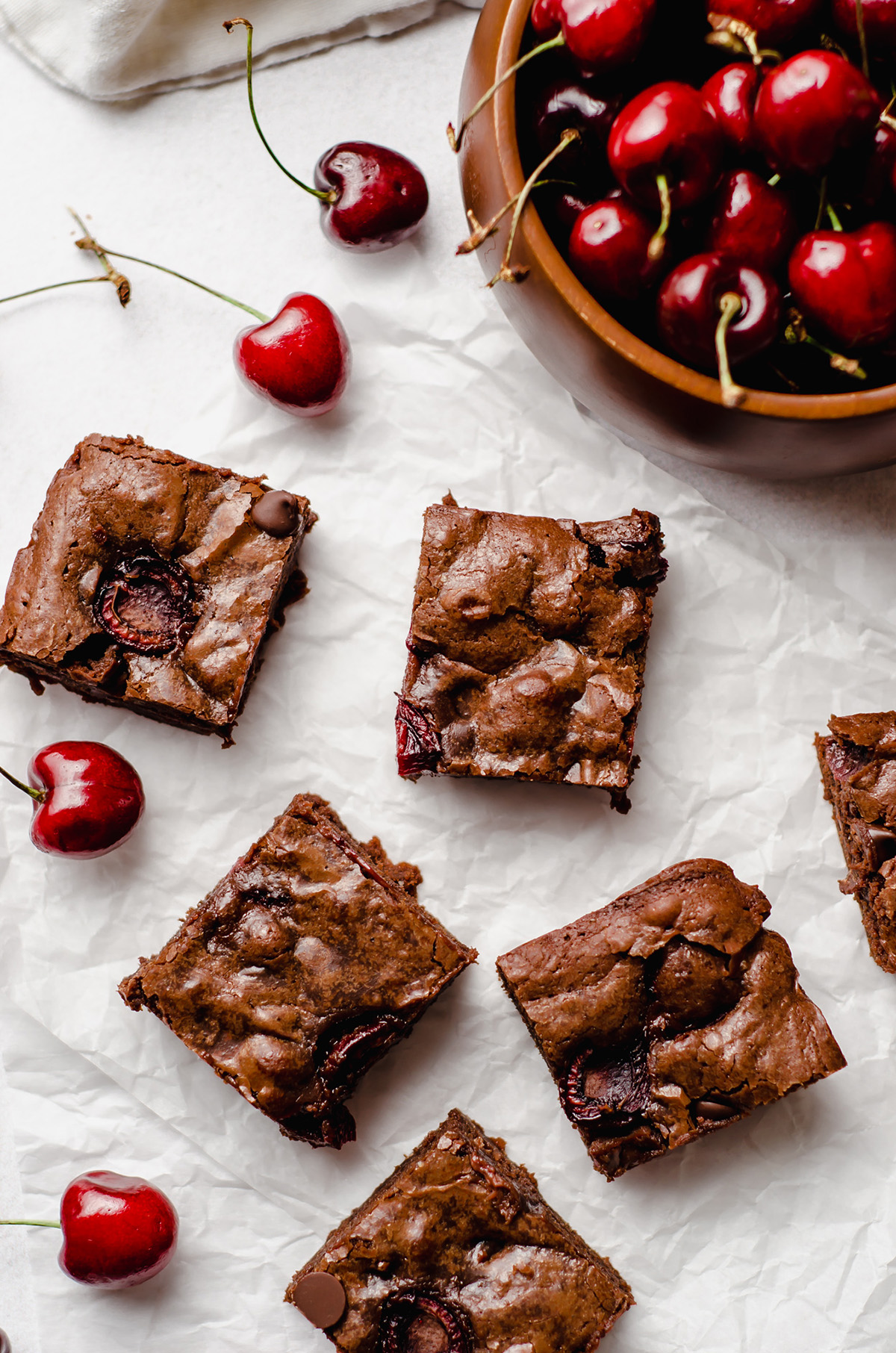 aerial photo of cherry brownies and a bowl of cherries