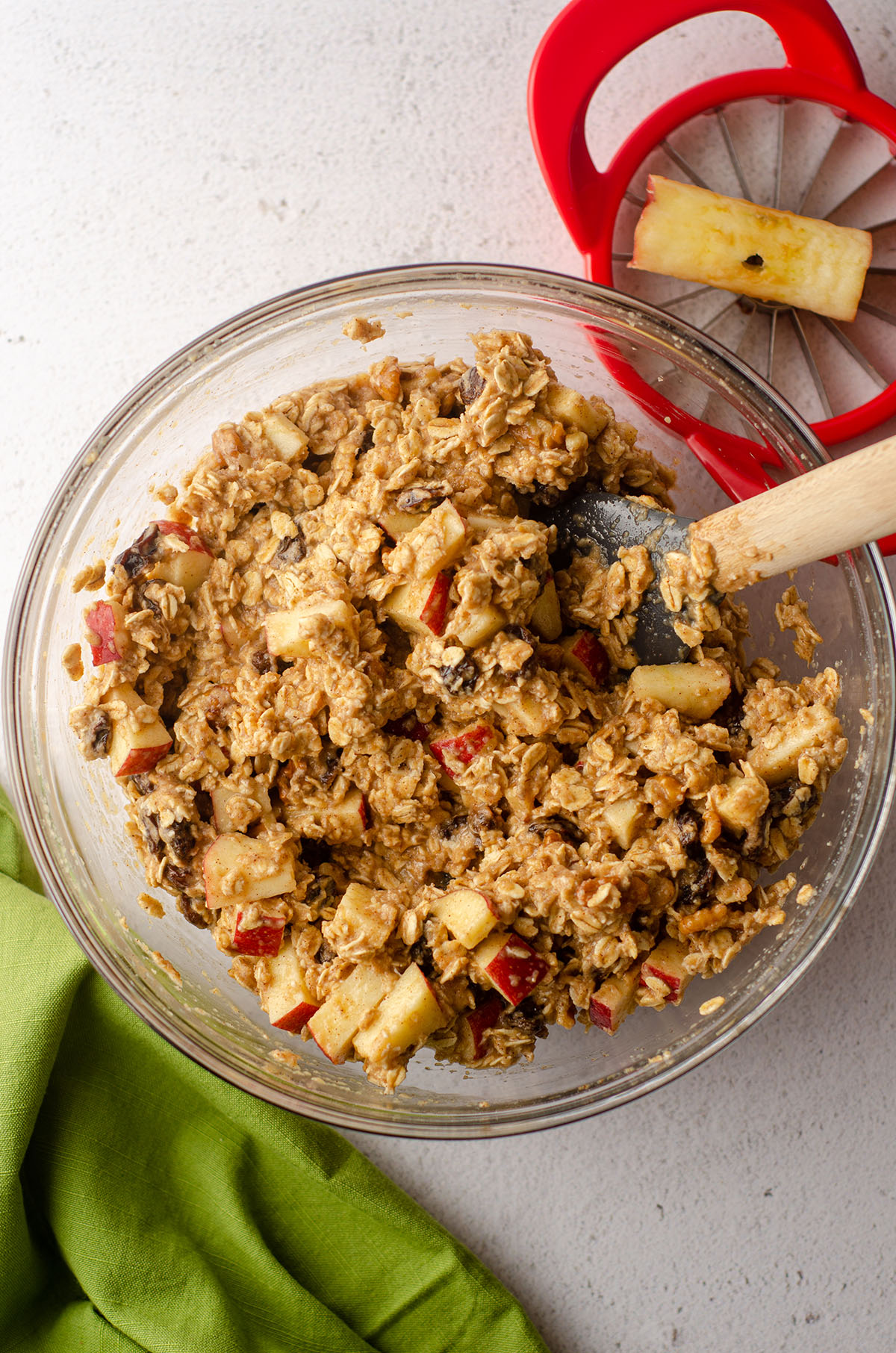 apple oatmeal mixed in a bowl ready to bake in a casserole dish