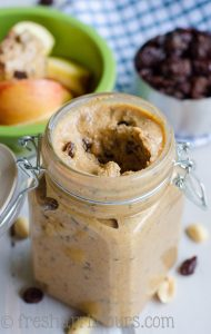 Homemade Cinnamon Raisin Peanut Butter: Mouthwatering homemade peanut butter that is lightly spiced with cinnamon and sweetened up with raisins.