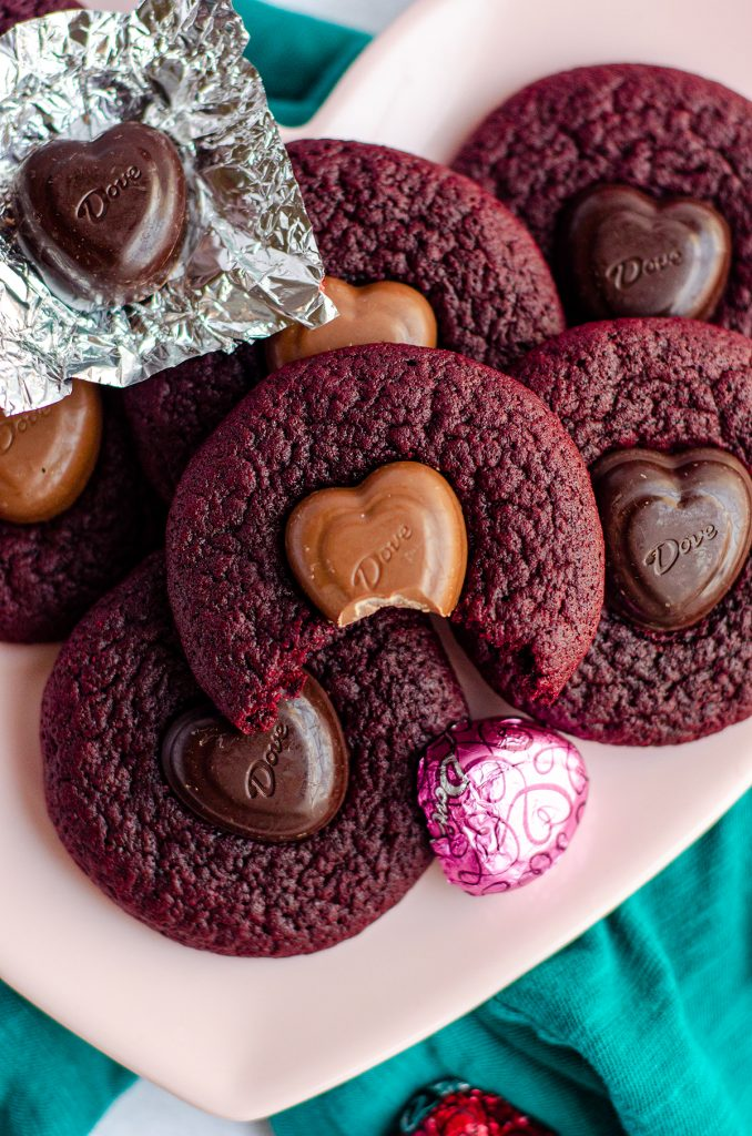 Red Velvet Blossom Cookies: Soft and chewy red velvet cookies, topped with a chocolate heart. No box mix required-- they're made completely from scratch!