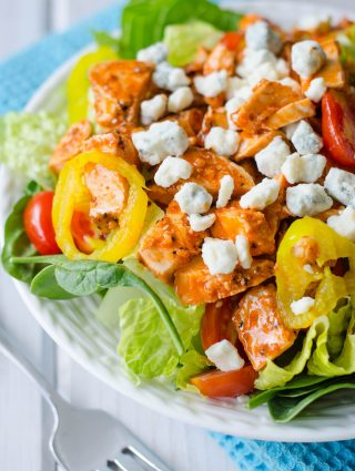 Buffalo Blue Salad: This protein-packed salad features spicy buffalo chicken, crisp banana peppers, juicy grape tomatoes, and tangy blue cheese crumbles.