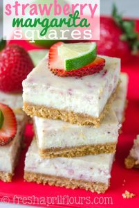 Strawberry Margarita Squares: A tart and creamy lime cheesecake filling is bursting with juicy strawberries and jazzed up with tequila. Perfect for a summer picnic!
