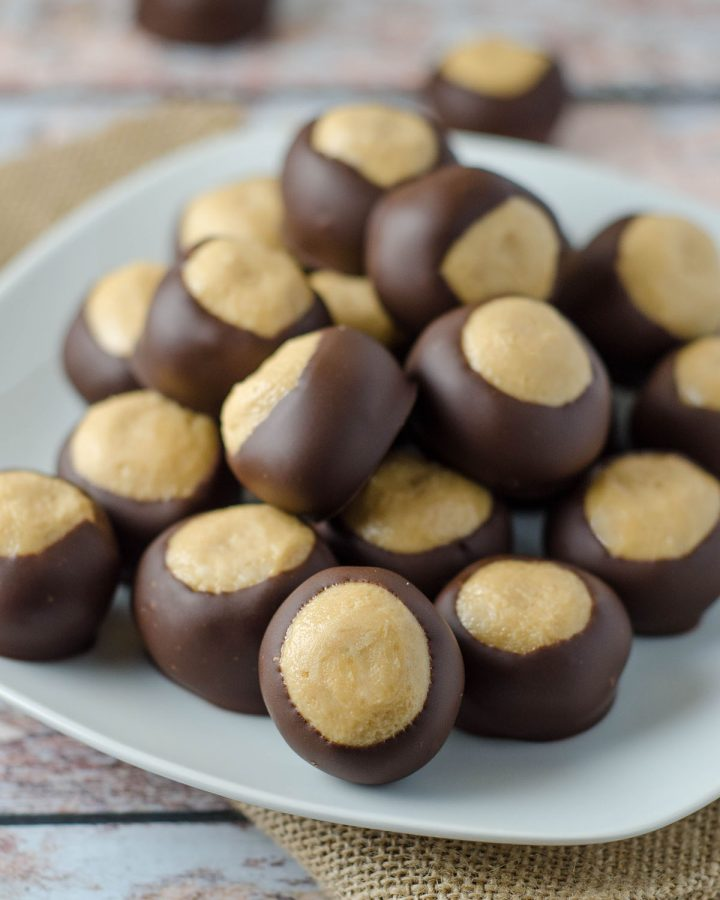 Buckeye Candy: Easy, melt-in-your-mouth peanut butter buckeye balls dipped in chocolate. A classic!