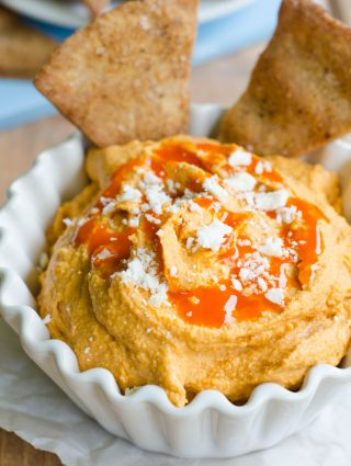 Creamy Buffalo Hummus: Smooth hummus loaded with spices and creamy blue cheese, perfect for dipping with homemade pita chips or your favorite vegetables.