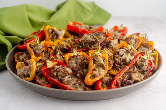 "Mini Philly Cheesesteak Stuffed Peppers: Don't let the ""mini"" part fool you-- these bite-size peppers are packed with tons of flavor! Recipe includes instructions for four large Philly cheesesteak stuffed peppers."