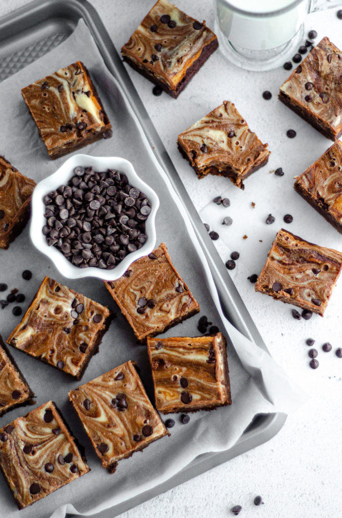 aerial photo of cut brownies in a group with a small bowl of mini chocolate chips