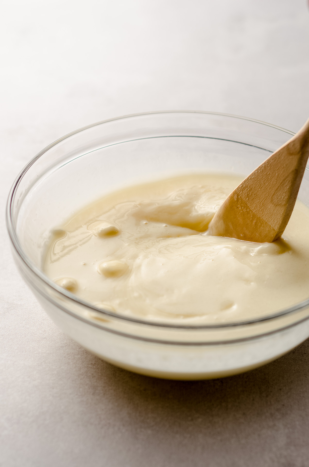 stirring lemon ganache with a spoon
