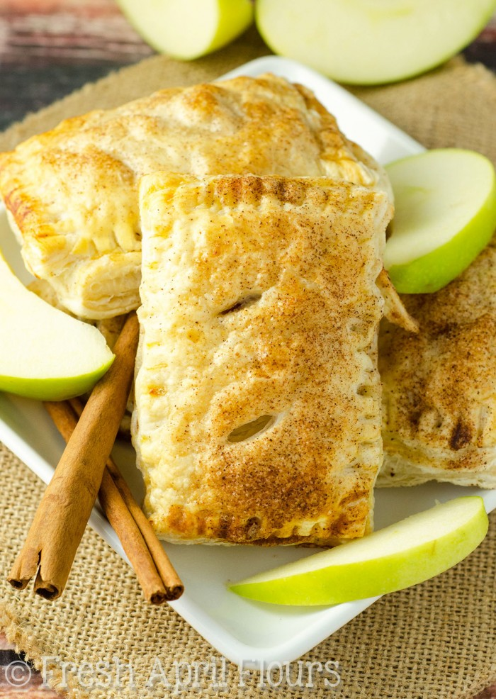 Simple handheld pies filled with spiced apples and made with puff pastry for an easy assembly and even easier eating!