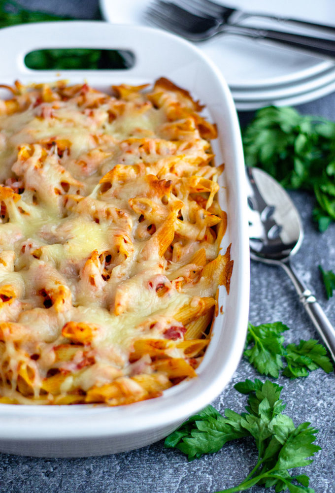 baked ziti in a baking dish ready to serve