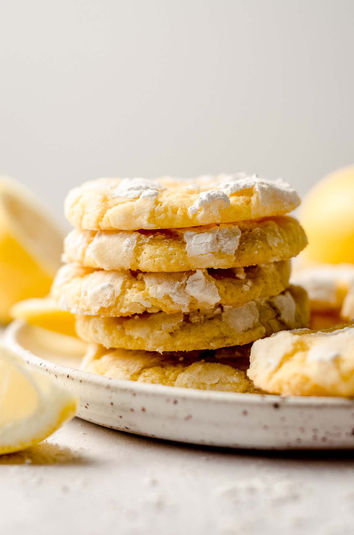 a stack of lemon crinkle cookies on a plate