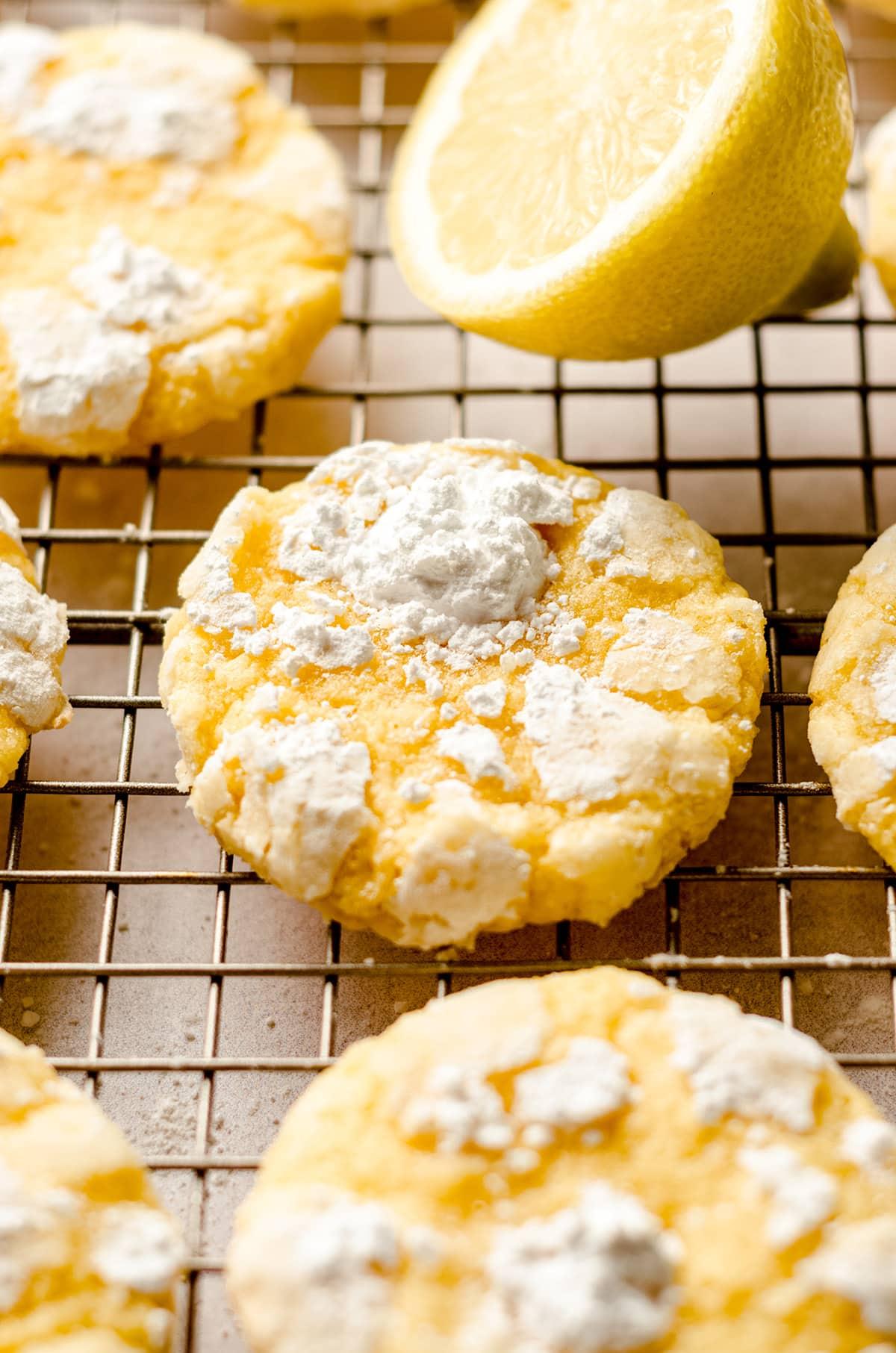 lemon crinkle cookies on a cooling rack