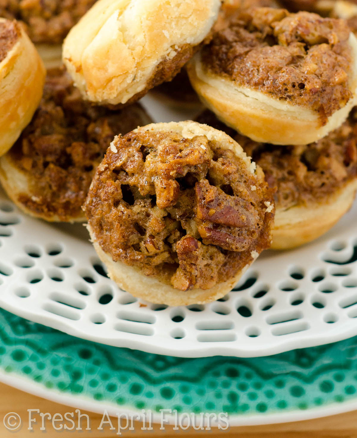 Pecan Pie Tarts: Bite-size pie tarts made with my favorite homemade pie crust and a soft and crispy pecan pie filling.
