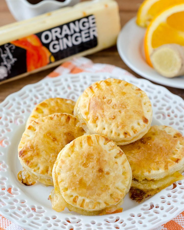 Cheesy Orange Marmalade and Ginger Puff Pastry Bites: An orange marmalade filling is combined with creamy orange and ginger cheese inside a flaky puff pastry shell. Seal the deal with an orange and ginger infused hot fudge sauce to dip or drizzle your pastries with!