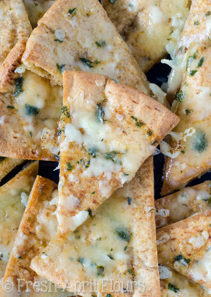 Homemade Cheese & Herb Pita Chips: Oven baked pita chips seasoned with parsley, chives, olive oil, and creamy herbed cheese.