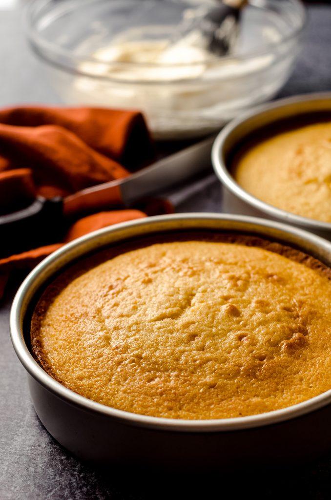 orange creamsicle layer cake baked in a baking pan
