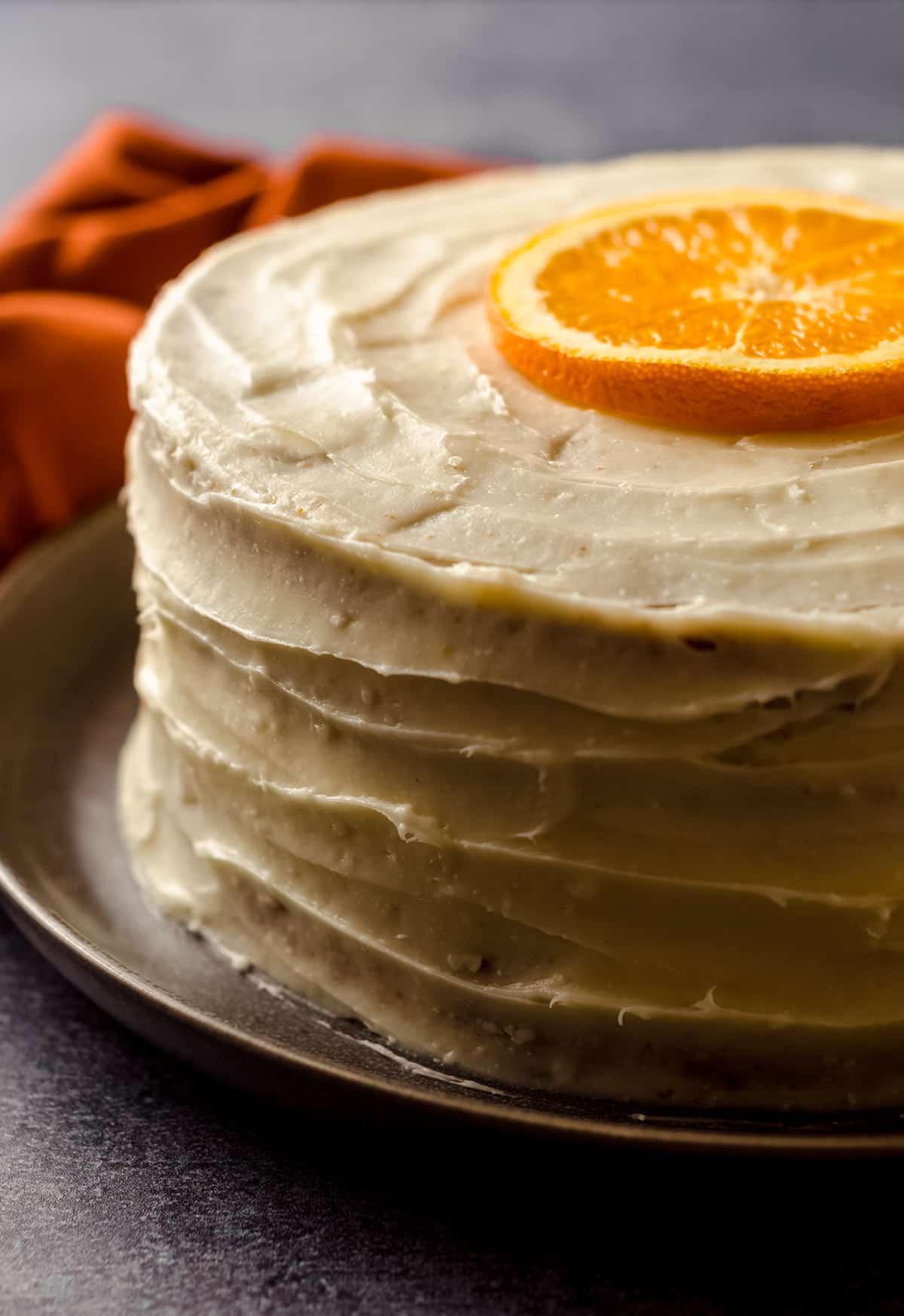 orange creamsicle layer cake on a plate