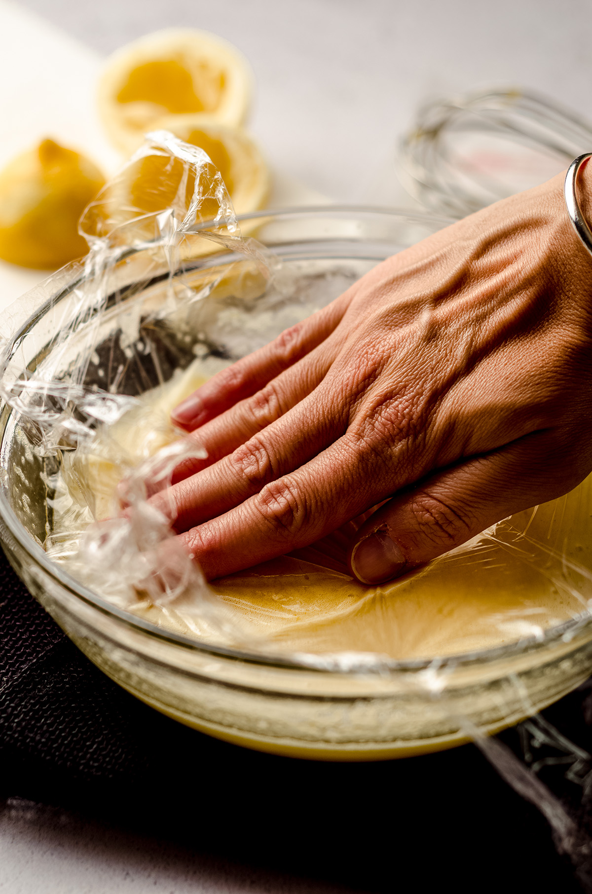 covering lemon curd with plastic wrap