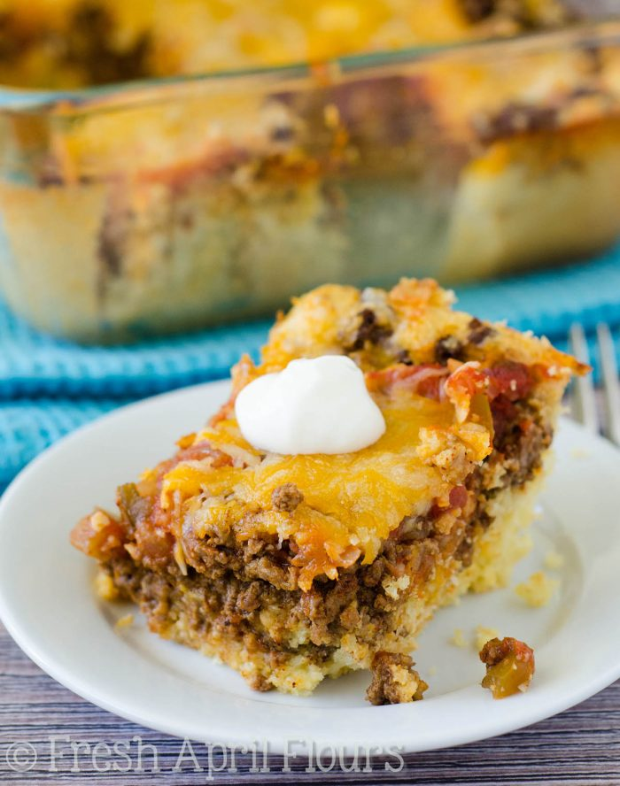 Baked Taco Casserole: An easy casserole layered with quick cornbread, seasoned meat, salsa, and cheese. Perfect for a quick weeknight meal and makes great leftovers!