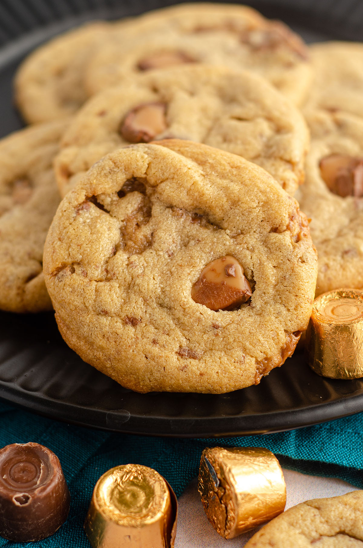 peanut butter rolo cookies on a black plate