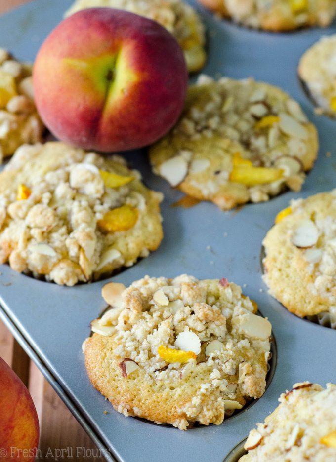 Peach Almond Streusel Muffins: Moist and tender peach muffins, accented with almond extract and topped with a sweet and crunchy almond streusel.