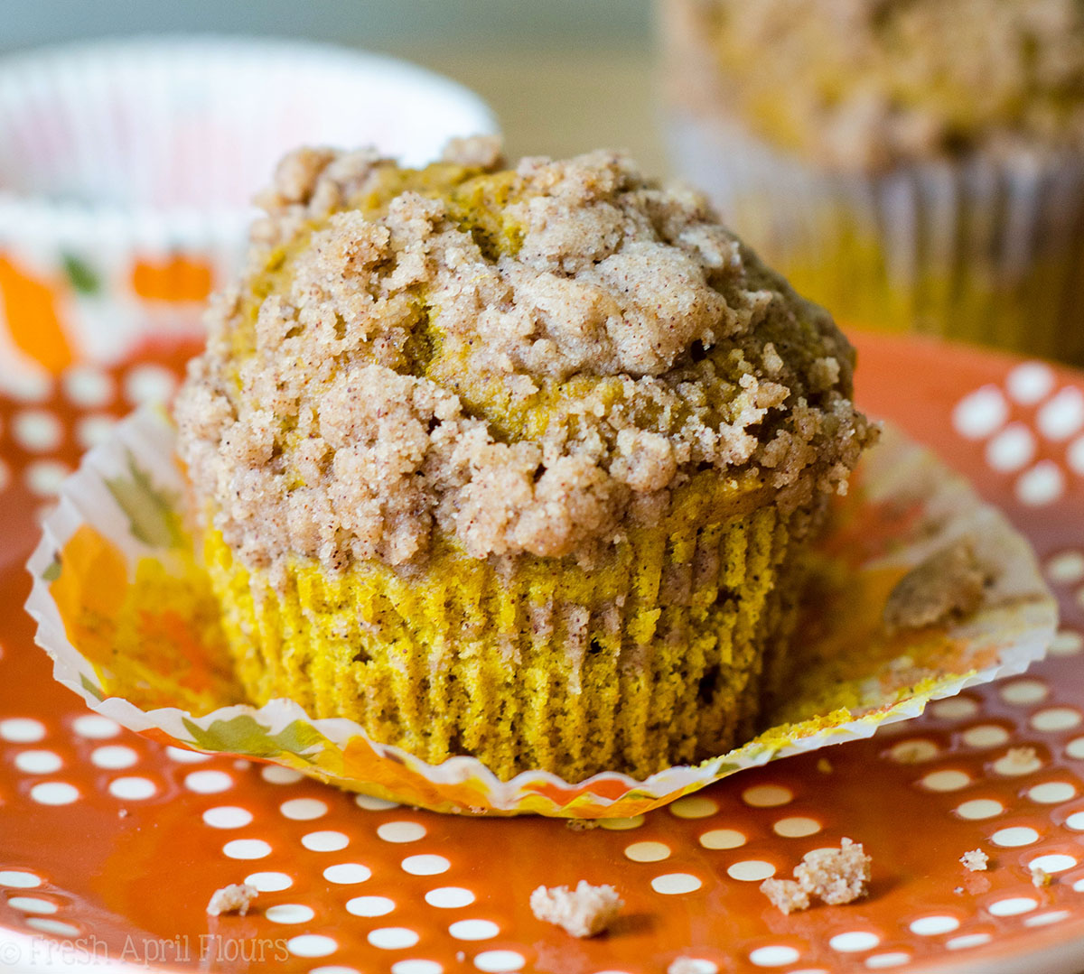 Pumpkin Streusel Muffins: Moist and tender muffins made with real pumpkin and all the warm flavors of fall, topped with an irresistible pumpkin spice streusel.