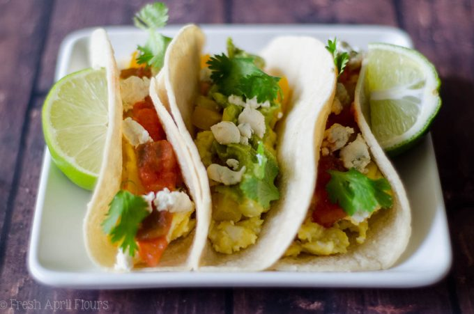 Vegetarian Breakfast Tacos: Mix and match your favorite toppings with the base of creamy goat cheese scrambled eggs and seasoned peppers and onions. Perfect for a breakfast buffet to please a crowd.