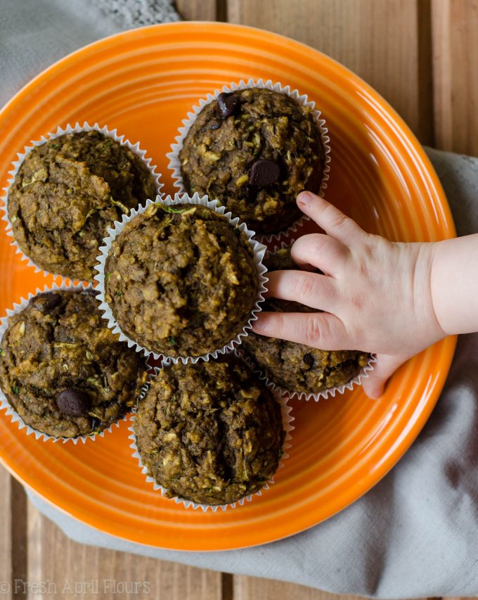 Toddler Muffins: Whole wheat muffins made with shredded zucchini and pureéd pumpkin, sweetened with mashed bananas, applesauce, and minimal sugar. Suitable for toddlers, children, and adults!