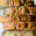 Funfetti Quick Bread: An easy vanilla almond quick bread filled with colorful sprinkles, perfect for any celebration. No mixer required!