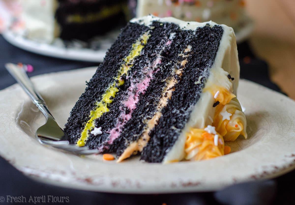 slice of black velvet layer cake on a plate