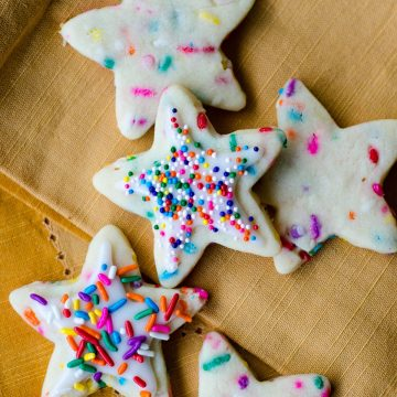Funfetti Cut-Out Sugar Cookies: No dough chilling necessary for these soft cut-out sugar cookies that are filled with colorful sprinkles and perfect for any occasion. Crisp edges, soft centers, and completely customizable in flavor and shape!