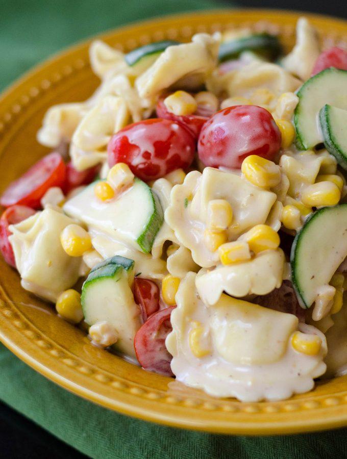 Summer Pasta Salad: A lightly creamy tortellini pasta salad filled with summer's best vegetables.