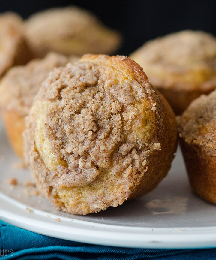 Coffee Cake Muffins: Buttery, brown sugar muffins topped with a cinnamon streusel are everything you love about coffee cake in handheld form!