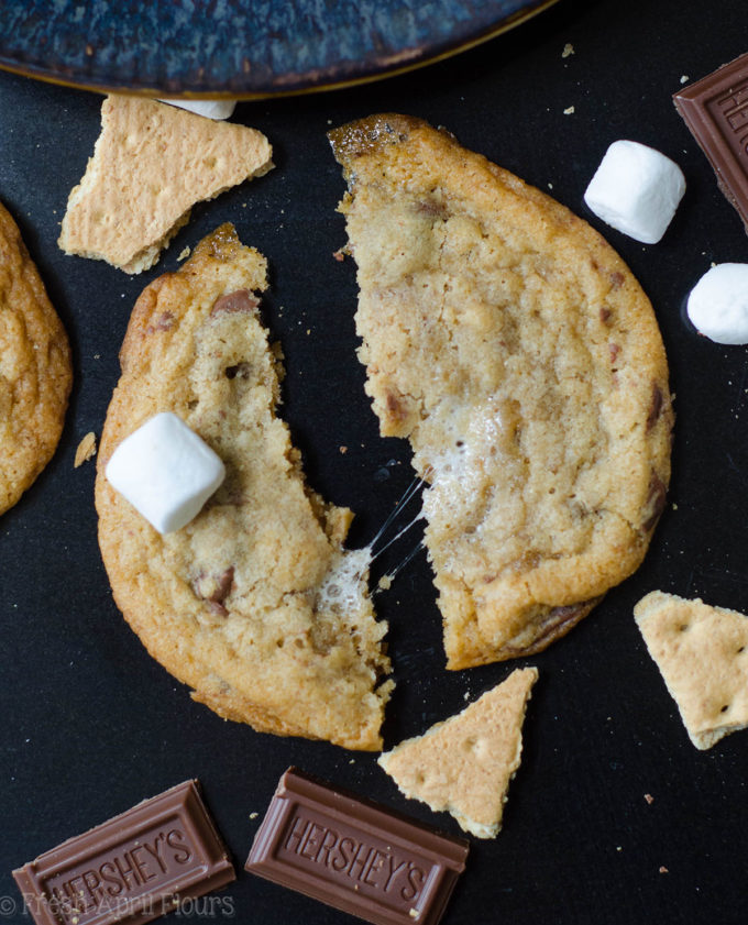 S'mores Cookies: Classic milk chocolate chip cookies scattered with gooey marshmallows and crunchy graham cracker crumbs.