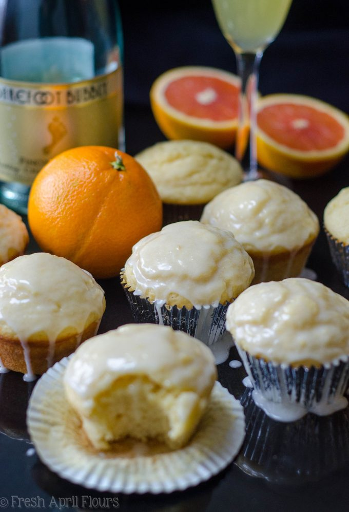 Glazed Mimosa Muffins: Tender citrus muffins made with a champagne reduction and topped with a boozy orange glaze are the sweetest way to get your mimosa fix.