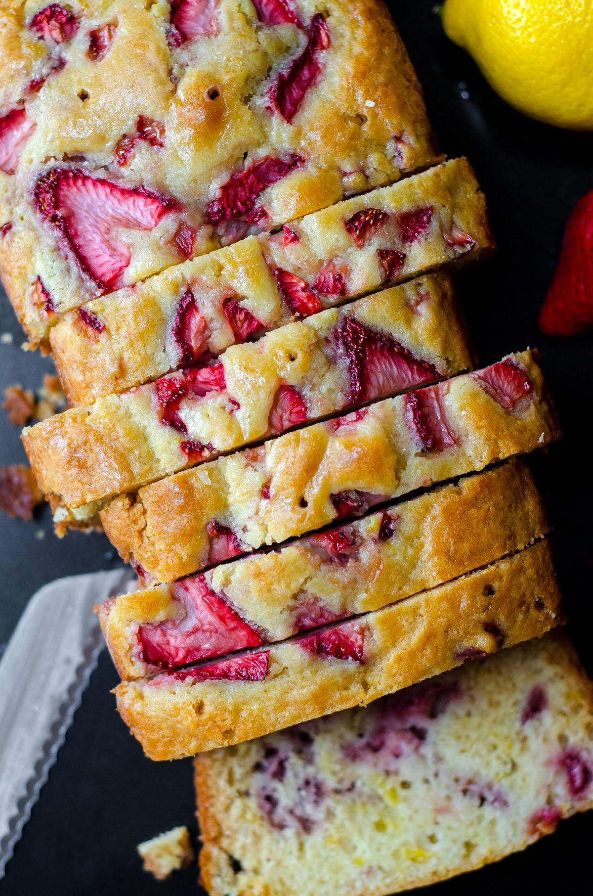 A simple quick bread loaded with strawberries and covered in a lemonade glaze. Perfect for summer!
