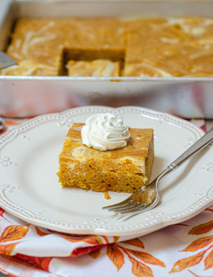 Pumpkin Cheesecake Swirl Sheet Cake: Dense and flavorful pumpkin cake swirled with sweet and creamy cheesecake.