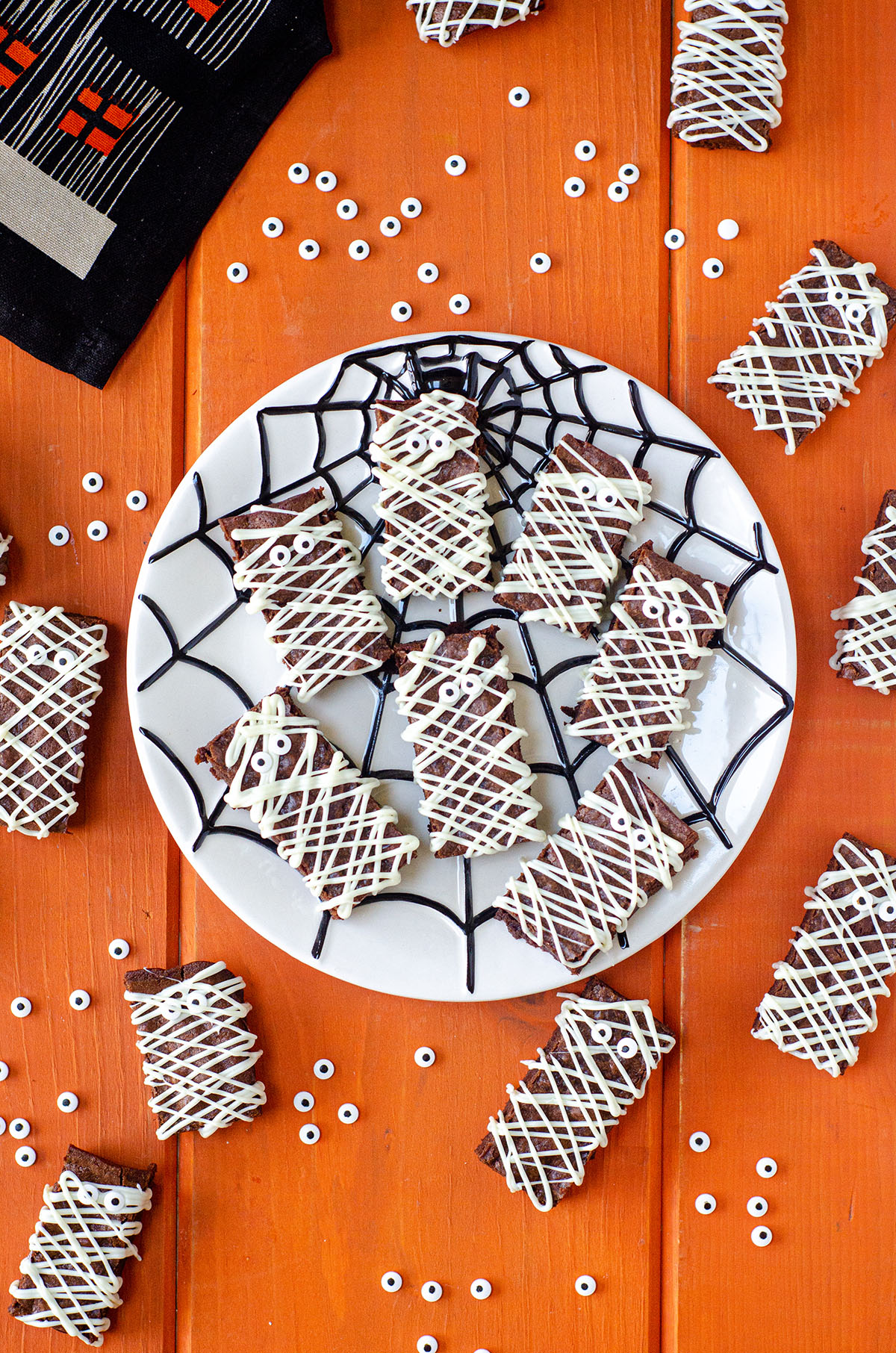 aerial photo of mummy brownies on a spider web plate