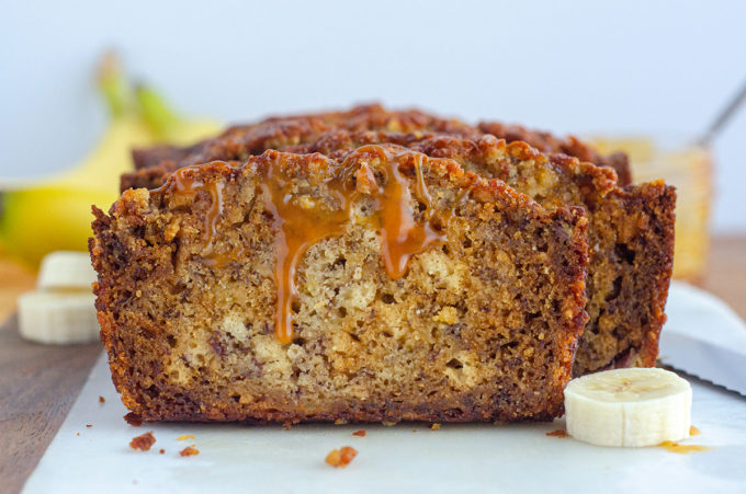 loaf of banana bread drizzled with caramel sauce