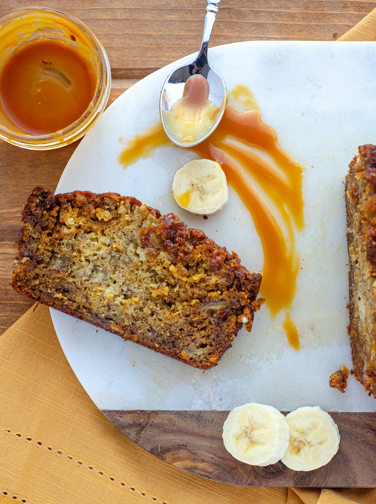 Classic banana bread gets swirled with salted bourbon caramel sauce for a jazzy take on the original.