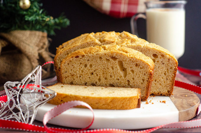 loaf of eggnog bread with christmas decor around it