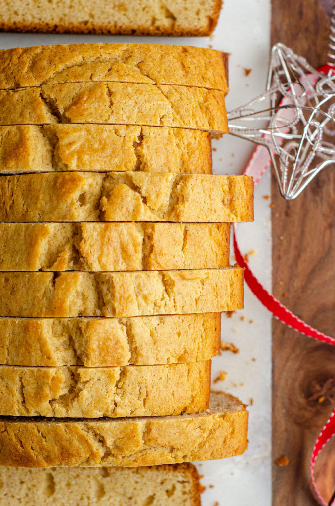closeup of sliced eggnog bread and silver star ornament in background