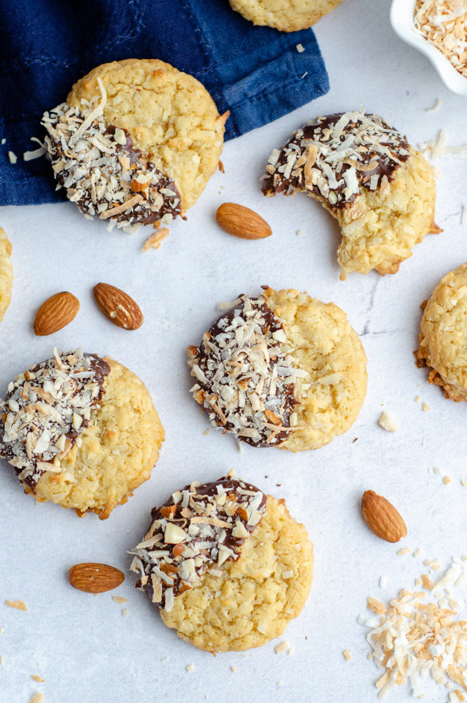 Almond Joy Coconut Cookies: Easy coconut drop cookies, dipped in chocolate and sprinkled with toasted coconut and chopped almonds.